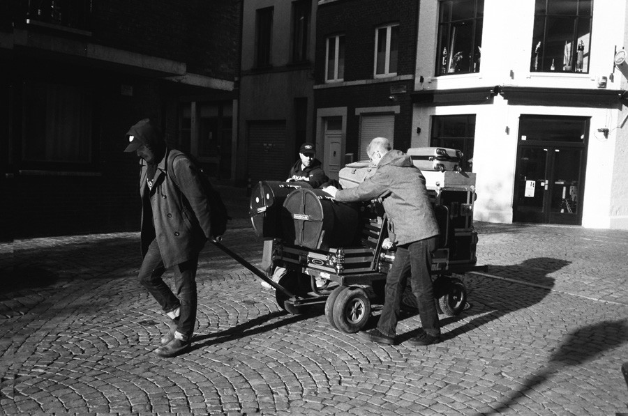 Tim Kinsella, Theo Katsaounis, and Jeremy Boyle load out the morning after a show on November 14, 2018, in Liège, Belgium, during Joan of Arc's last European tour.
