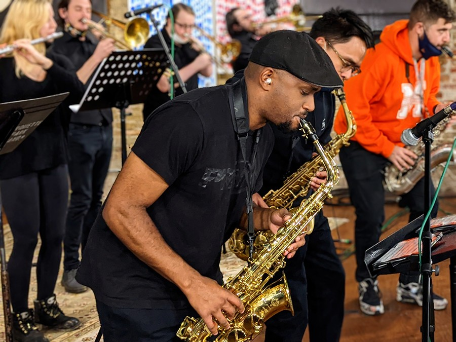 Alto saxophonist Luc Mosley and most of the rest of the horn section