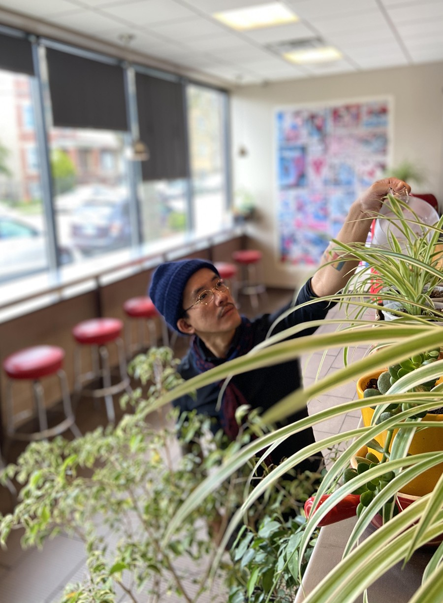Ethan Lim and the burgeoning herb garden at Hermosa