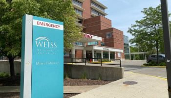 Neighbors worry that the sale of the Weiss Hospital parking lot would signal the closure of the hospital itself.