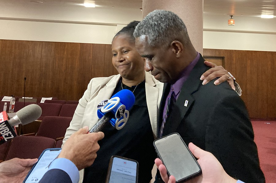 Aldermen Sophia King and David Moore weep while talking with reporters