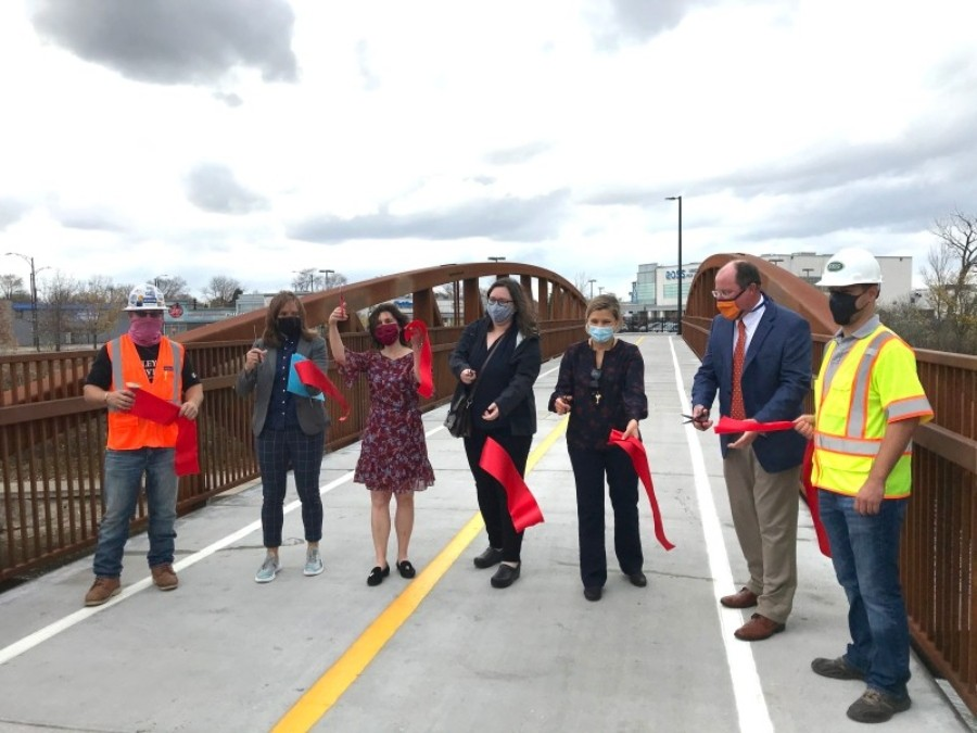 Ribbon-cutting for the Stone Free Bridge. Alderman Silverstein is third from the left.