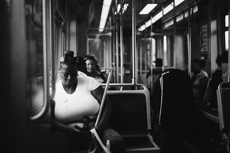 A woman heads westbound.
