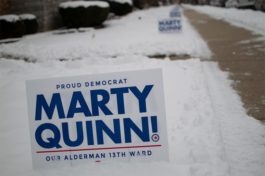 Yard signs for the incumbent as far as the eye can see.
