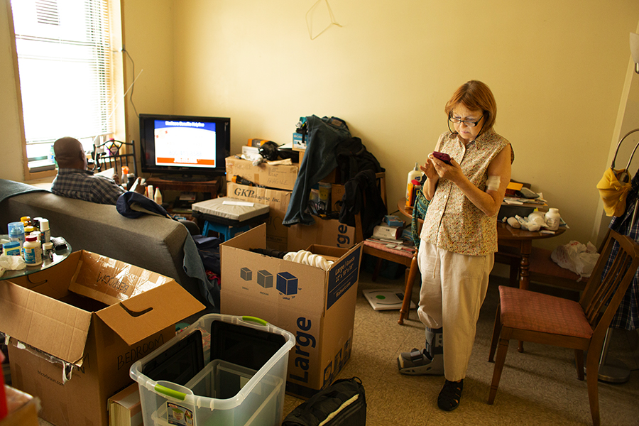 Longtime Lathrop residents Joseph Burrell and Cynthia Scott pack up their public housing apartment in preparation for a move to one of the development's rehabbed units.
