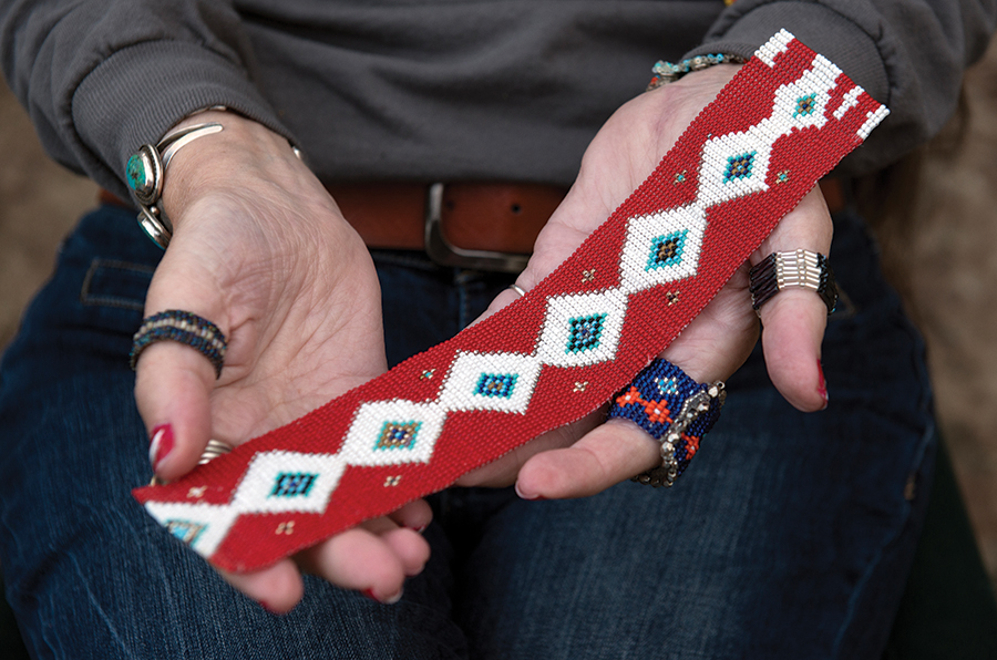 Vinyard Indian Settlement member Kathi Wolfe displays homemade jewelry.