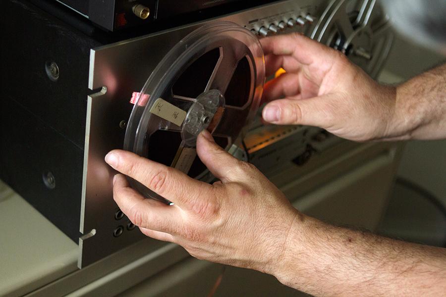 Derradji fits a tape to his reel-to-reel machine.
