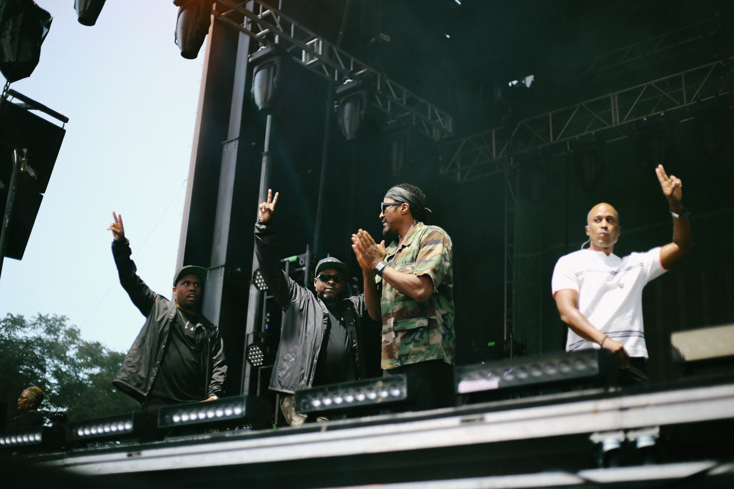 Consequence, Jarobi White, Q-Tip, and Ali Shaheed Muhammad greet their fans.