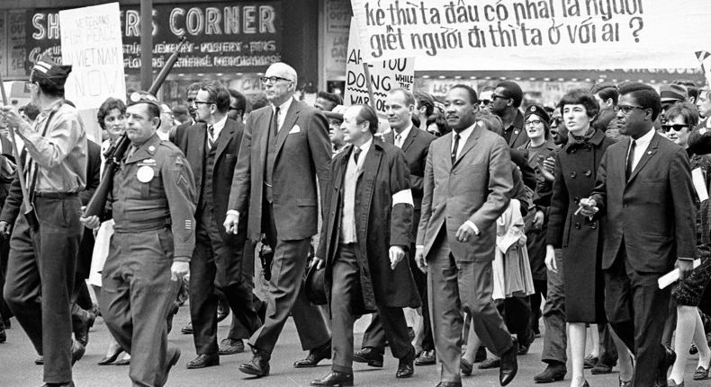 Dr. Martin Luther King leading an antiwar demonstration on State Street, 1967.