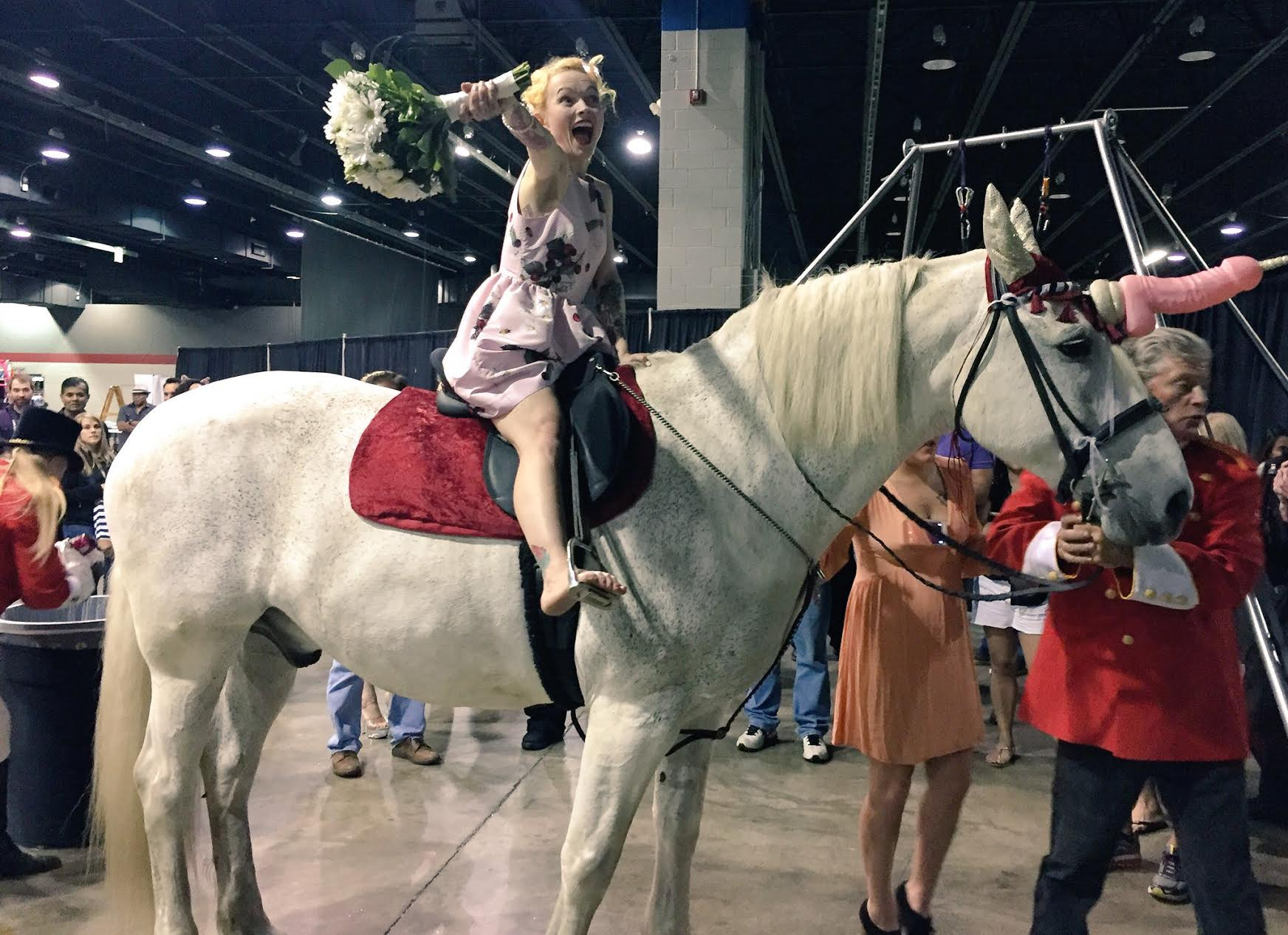 Adult film star Tita Cupcake DuJour on her penis unicorn as part of her wedding ceremony at Exxxotica