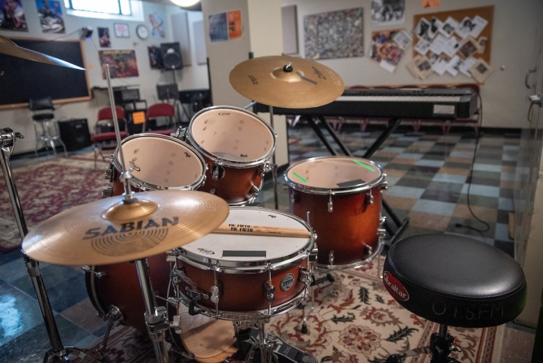A drum kit sits in an empty music room at the Old Town School of Folk Music