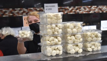 Devon Market worker with stacks of pelmeni