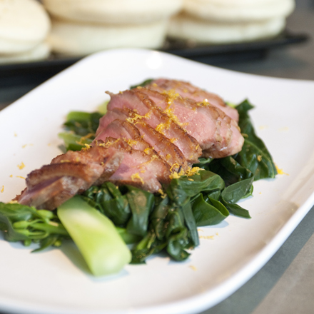 Tea-smoked duck breast on a bed of Chinese broccoli bears not a whiff of tea leaves.