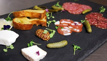 The Chestnut Provisions tasting is composed of charcuterie, cheese, pickles, and mustard—all made in-house.