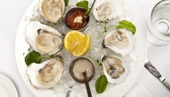 Bow & Stern's masterfully shucked oysters are flown in from waters on both coasts.