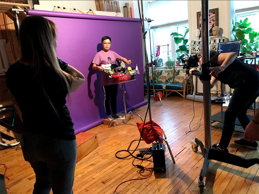 Lisa photographs <i>Reader</i> creative lead Sue Kwong for the Buy Local shoot as Jamie Ramsay offers prop advice.