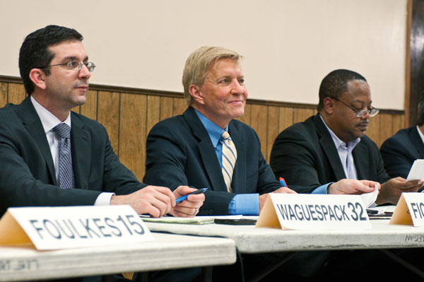 Aldermen Scott Waguespack, Robert Fioretti, and Roderick Sawyer listen during the budget hearing hosted by the City Council's progressive caucus.
