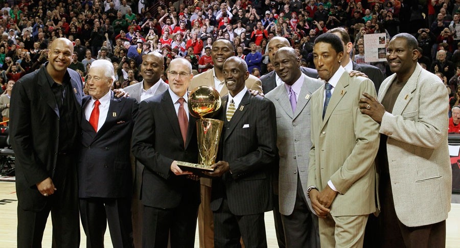 Members of the 1990-'91 Chicago Bulls celebrate the 20th anniversary of their championship season during halftime of a March 2011 game.