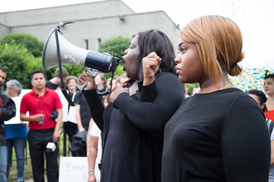 Chicago Call to Action Protest organizers Imani, left, and Kristen gave safety instructions before a march that shut down the Dan Ryan Expressway in July, showing how to lock arms so that the police could not easily break the group apart.