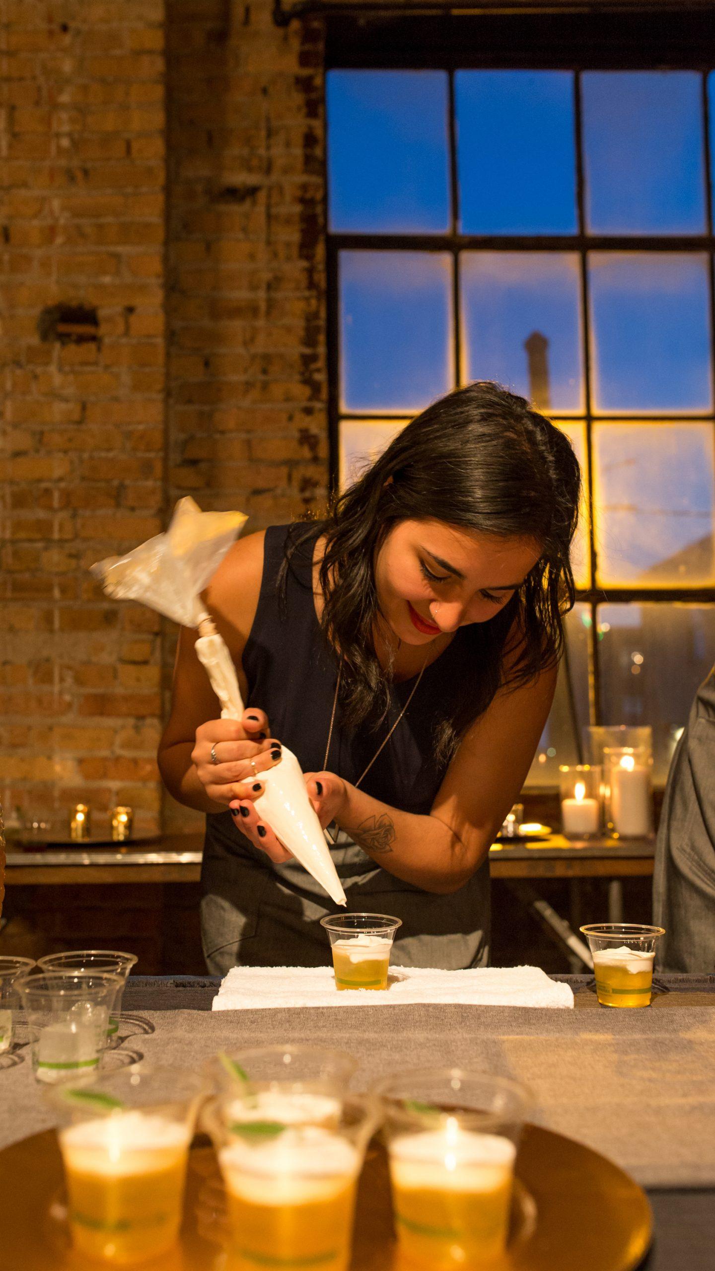 Mony Bunni of Boleo pipes marshmallow cream onto the cocktails