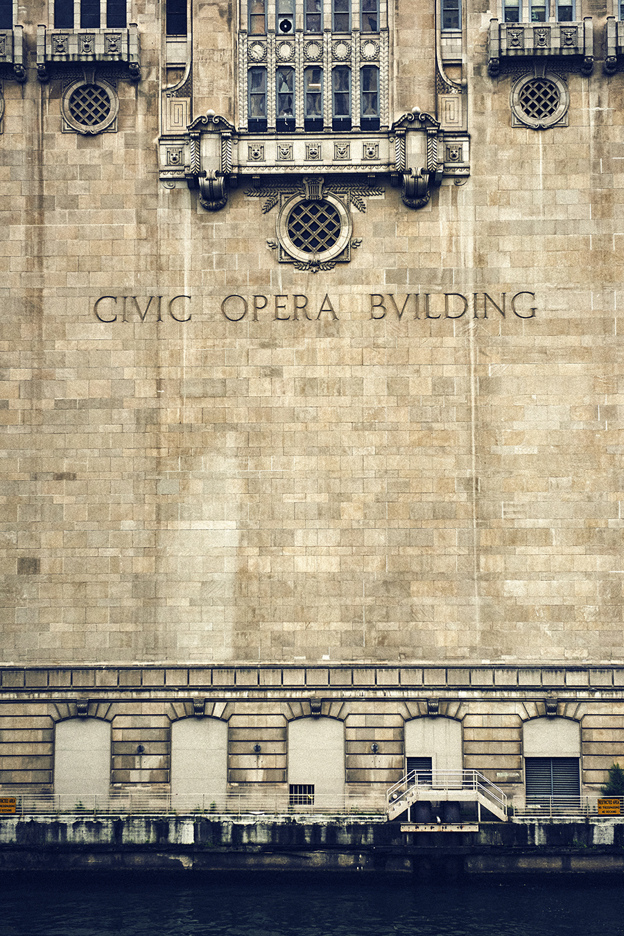Civic Opera across from the Ogilvie and Union Station stop.  According to Senior Deck Hand Dave Ling, there are 75 singing faces on the river side of the building.