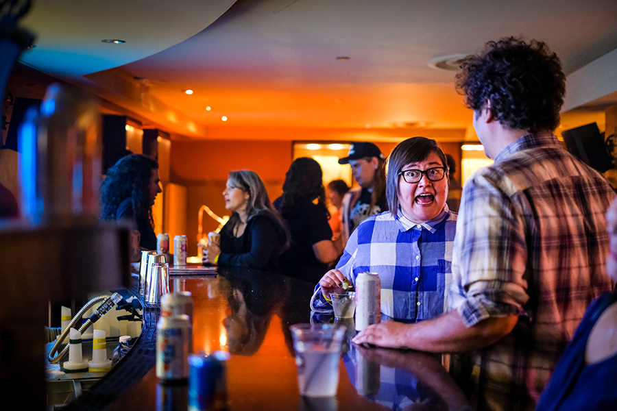 Christen Thomas at the Hard Rock Hotel bar during a 2017 Lollapalooza afterparty, where the lineup included the Black Lips, the Ponys, and the Life and Times