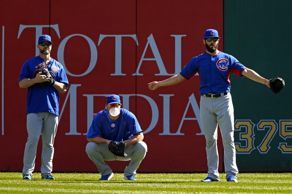 Jon Lester, center, will start against the Mets in game one on Saturday. Jake Arrieta, right, will start on Sunday.