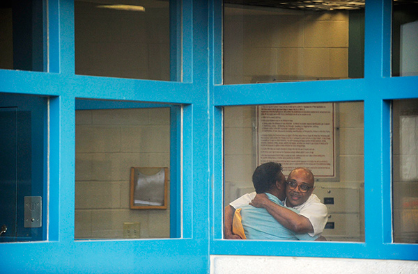 Andre Davis embraces his father, Richard, upon being released from prison.