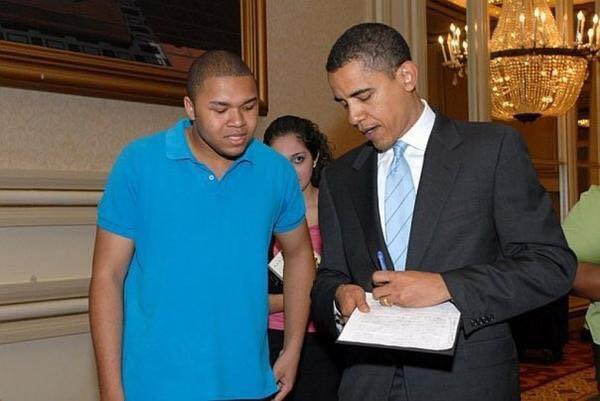 The author, left, then 17, with then-Senator Obama in 2006
