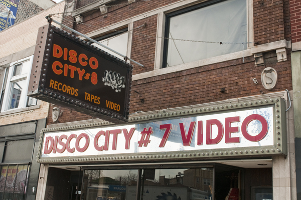 Disco City sells music, sure, but what's up with its contrasting signs?