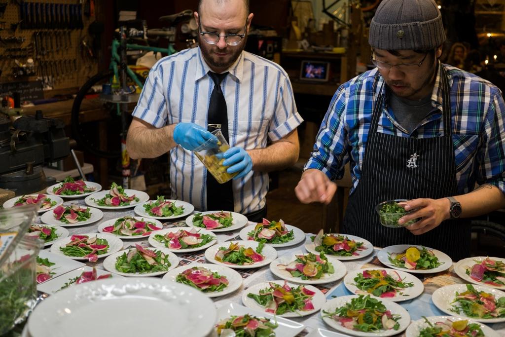 Toolan helps Kim plate the salads.