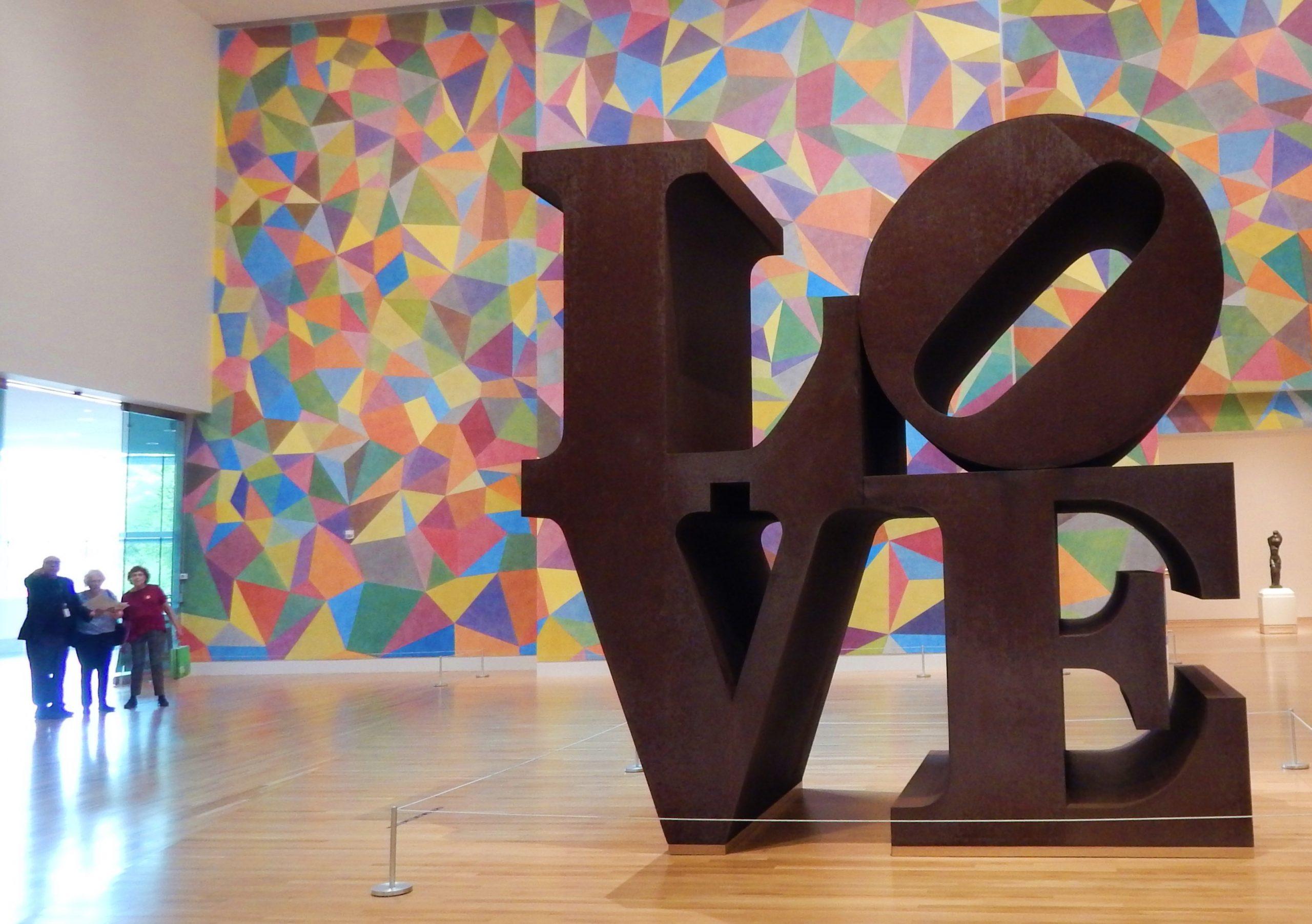 Robert Indiana's <i>Love</i> (1970), backed by Sol LeWitt's wall painting <i>#652</i> at IMA