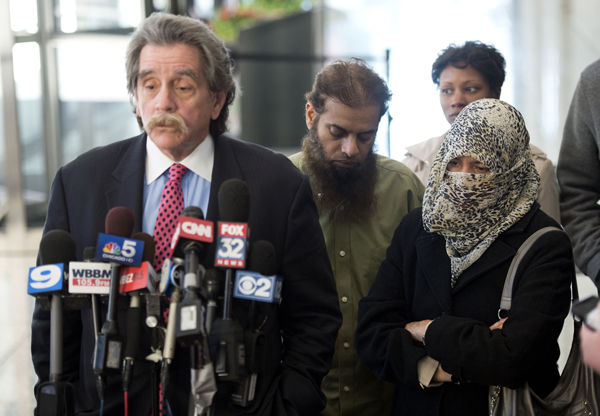 Thomas Durkin, the attorney for Mohammed Hamzah Khan, addresses reporters after an October 2014 bond hearing, as Khan's parents, Shafi and Zarine, look on.