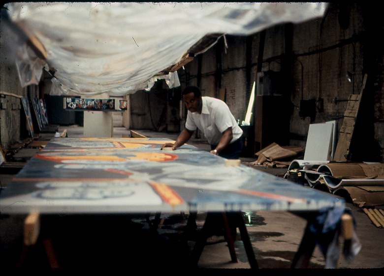 Eda at work on the mural in 1982