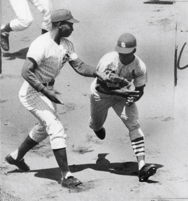 Cub Ernie Banks tags out Cardinal Lou Brock in July 1965.