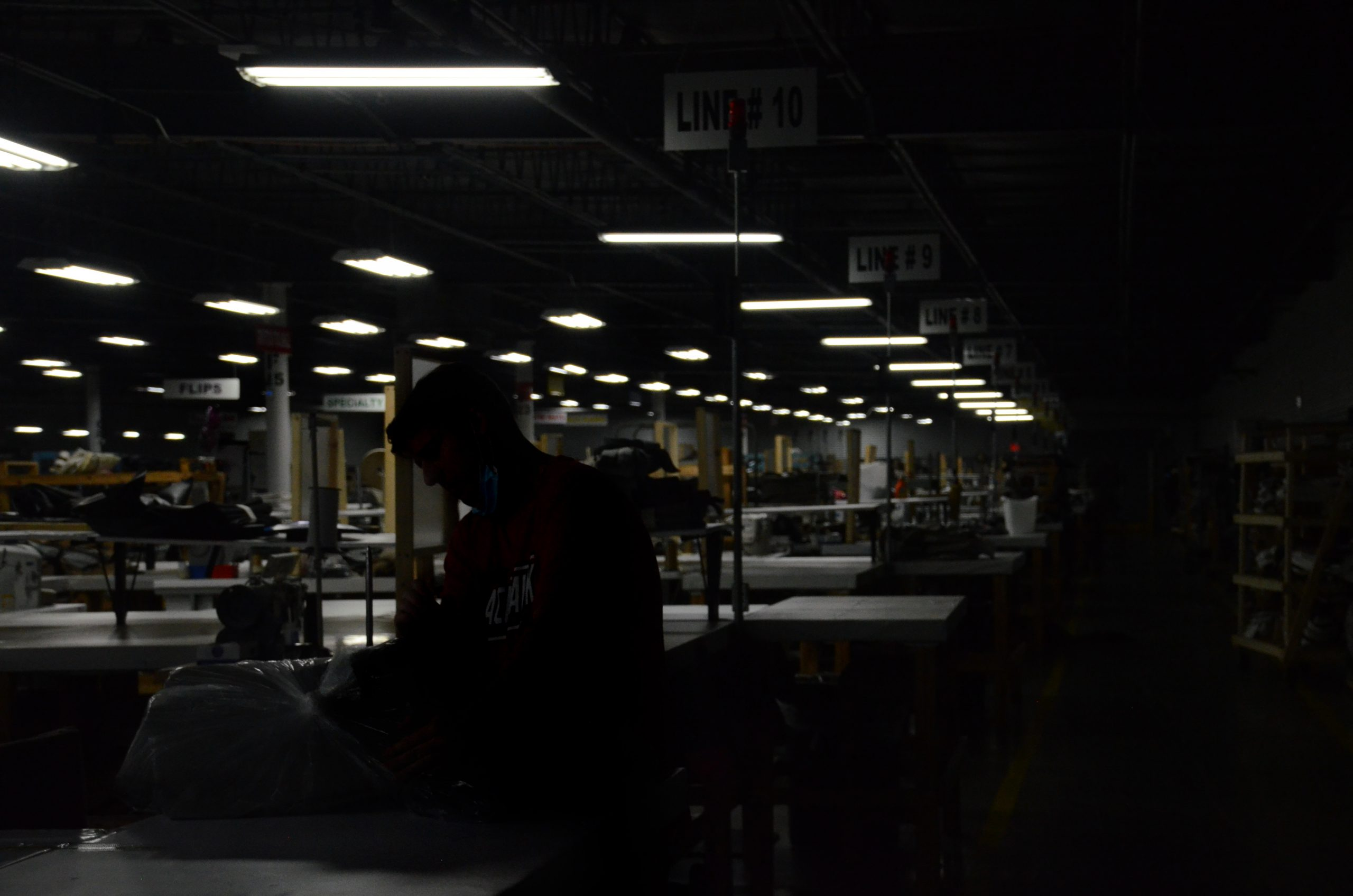 A worker organizes upholstery at a RV manufacturing plant.