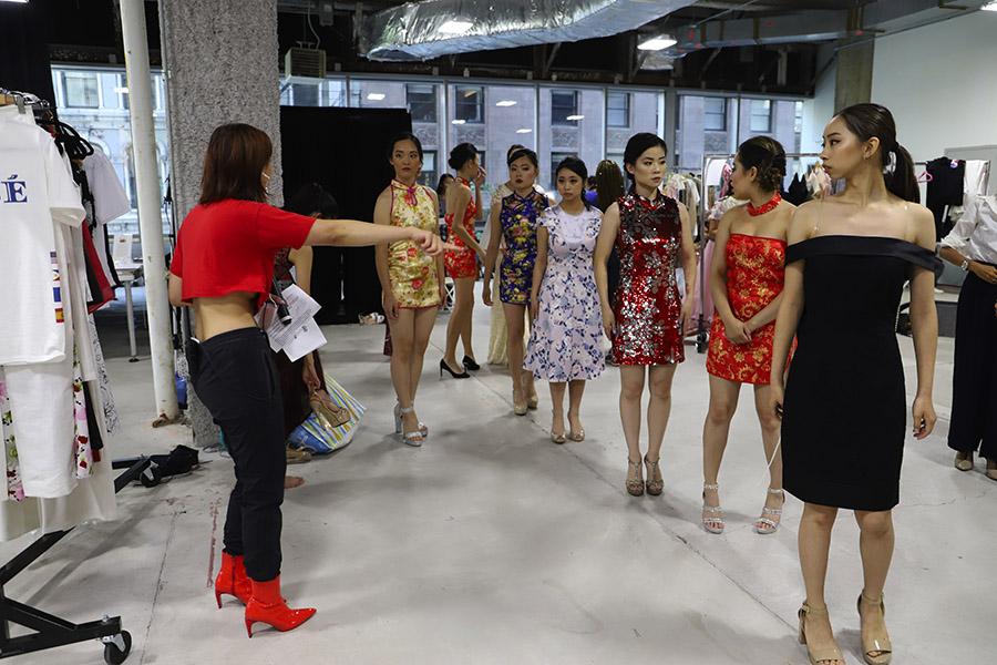 Ng gives instructions to the models.