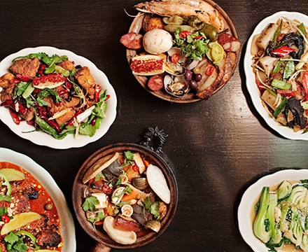 Clockwise from top middle: arroz gordo (fat rice), fat rice noodle, bok choy with pork stock, balichang catfish, African chicken, and shaking chile whitefish