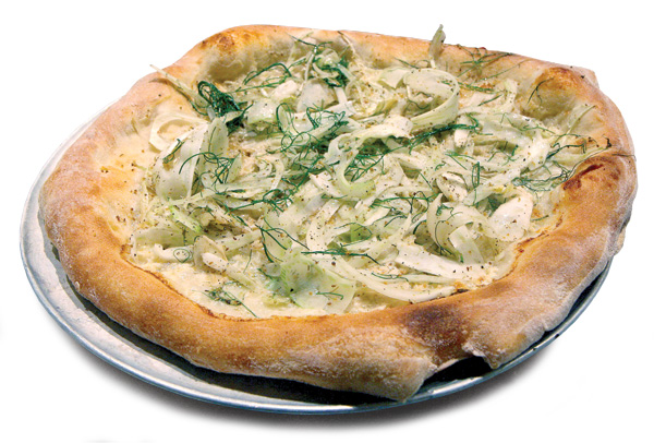 Pizza topped with Gorgonzola cream, shaved fennel, walnut pesto, and fennel pollen