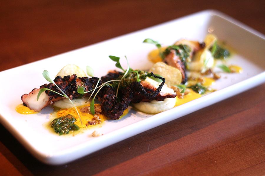 Grilled octopus, pommes puree, aji amarillo vinaigrette, fingerling potato chips, walnut pieces, baby cilantro, and freeze-dried aji amarillo powder