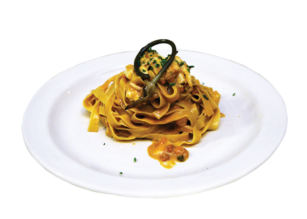 Fettucine with uni, lardo, crab, and pickled ramps