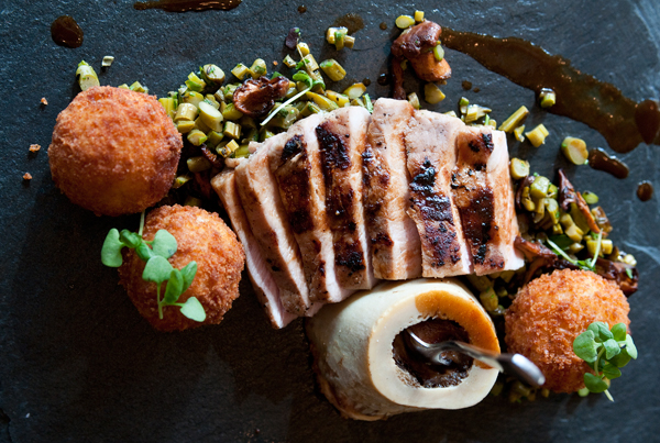 """Veal """"osso bucco""""—slices of loin accompanied by a marrow bone and a few arancini—is an """"historic"""" offering that works."""