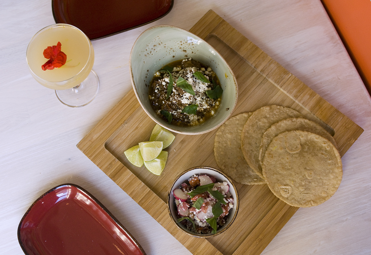 The lamb barbacoa is enhanced by pistachios and balanced by black garlic, basil, and queso fresco, and comes with tangy, malty beer tortillas.