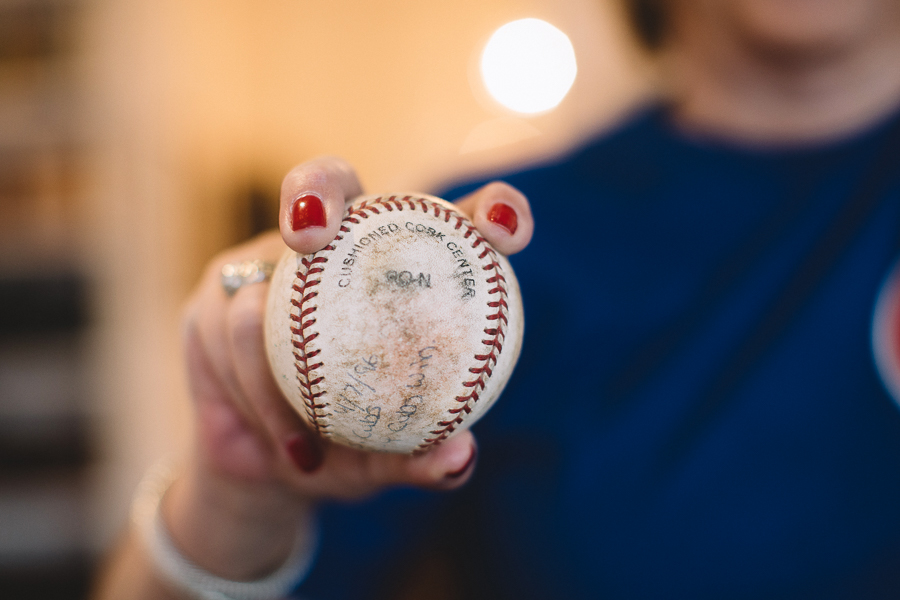 """Sherwin demonstrates the grip for a two-seam fastball with a baseball from the final Little League team she coached. """"Depending on where your thumb is on the bottom will control how it breaks,"""" she says."""