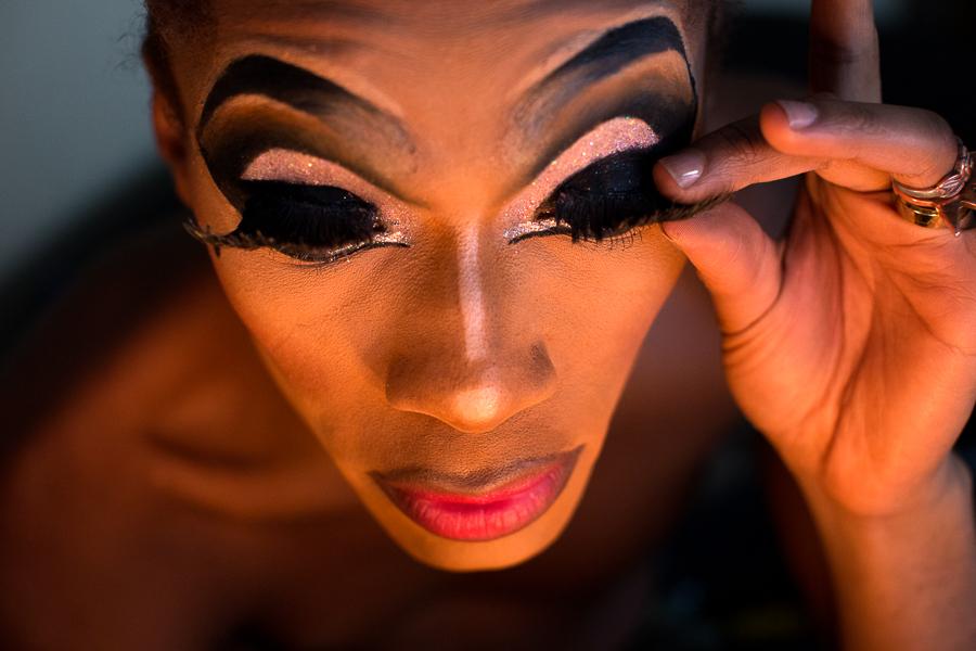 Heavy false eyelashes complete the Vixen's look.
