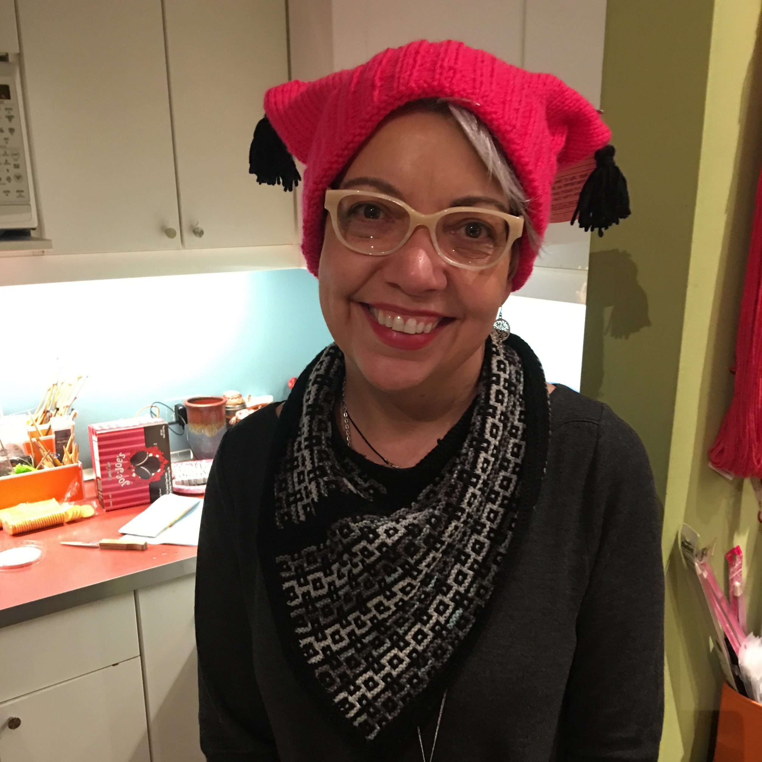 Sister Arts Studio owner Donna Palicka sports her pussyhat.