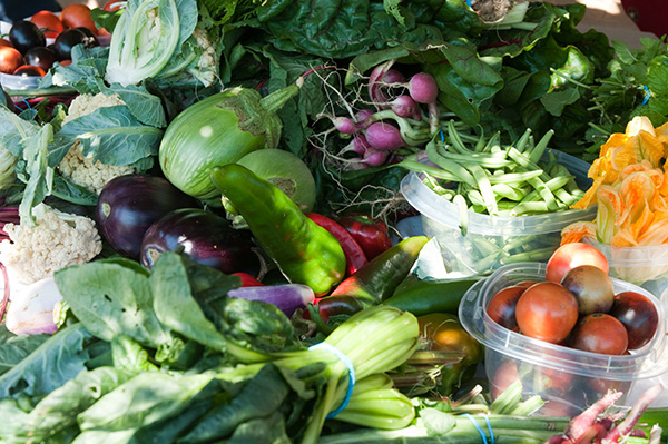The bounty of the refugees' communal crops, available at their weekly markets