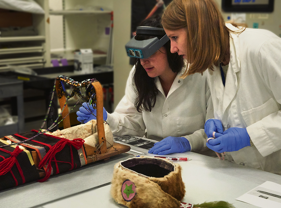 Assistant conservators Nicole Passerotti and Erin Murphy test for harmful chemicals that may be present due to old collection practices.