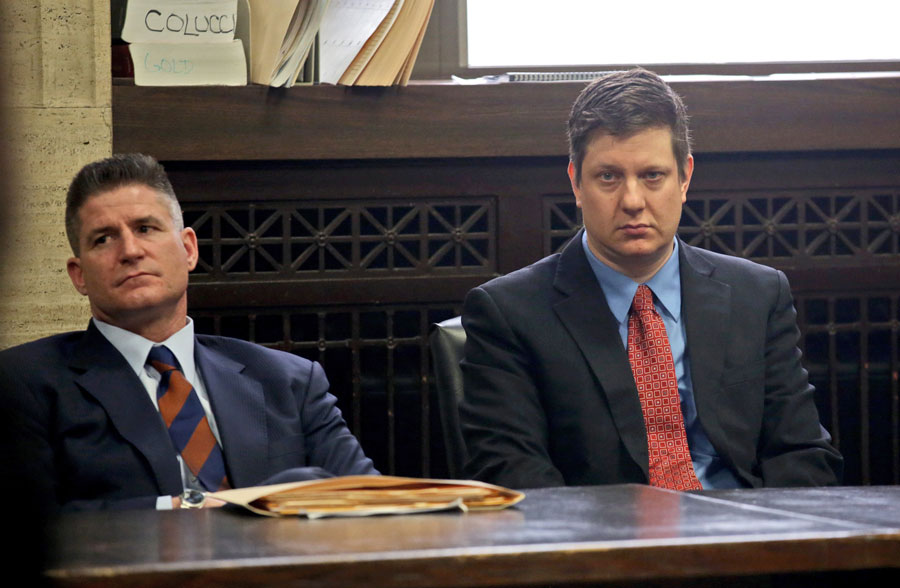 Herbert with his client Jason Van Dyke at the Leighton Criminal Courthouse in March 2016. Herbert argues that Van Dyke's shooting of Laquan McDonald was justified, and accuses city officials of sacrificing Van Dyke to save their own political skins.