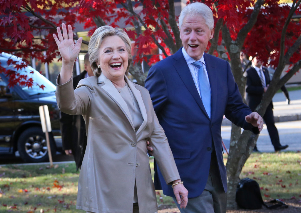 Democratic presidential nominee Hillary Clinton and her husband greet crowds after voting Tuesday in Chappaqua, New York.